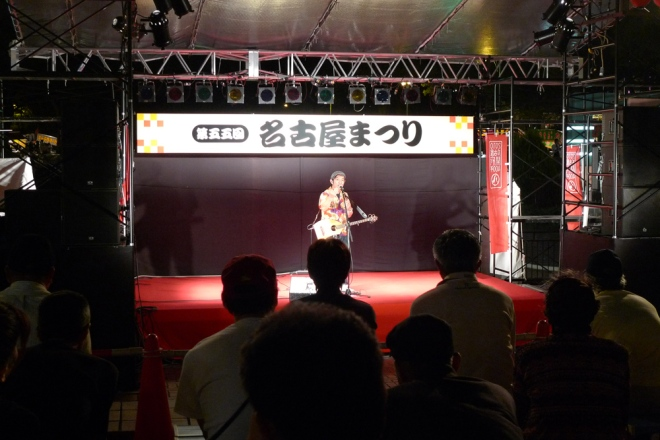 Some singer on stage singing........ the Kirin beer song